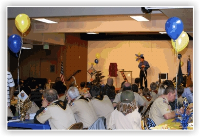 Magician Jeff Evans performs for a Blue and Gold Banquet.